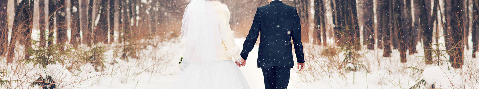 Newlyweds walking in the snow - Westgate Park City