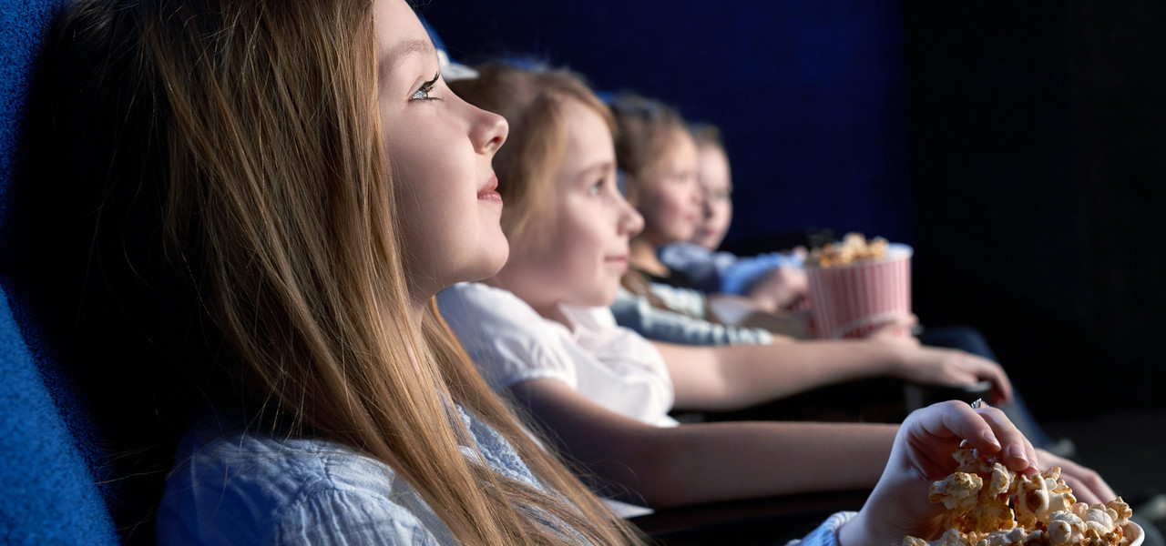 Youth Group Trip Hotel Deals - Group of kids watching a movie