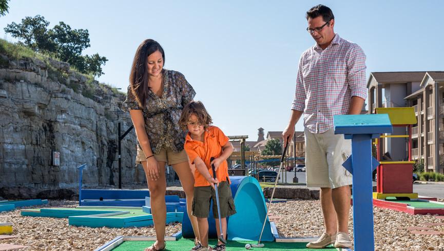 Branson Table Rock Lake Resort at Emerald Pointe | Family Playing Mini Golf