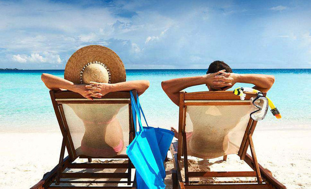 Couple relaxing on the beach | Westgate South Beach Resort