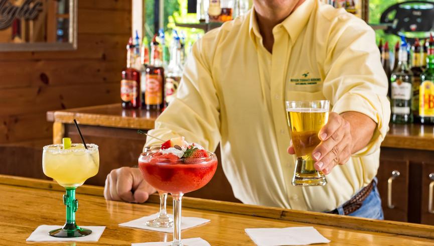 Bar tender serving multiple drinks - Westgate Smoky Mountain Resort