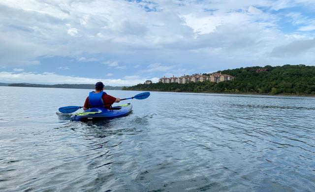 Man canoeing on the lake | Westgate Branson Lakes Resort