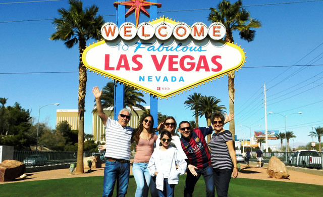 Family in front of Las Vegs Sign | Westgate Las Vegas Resort