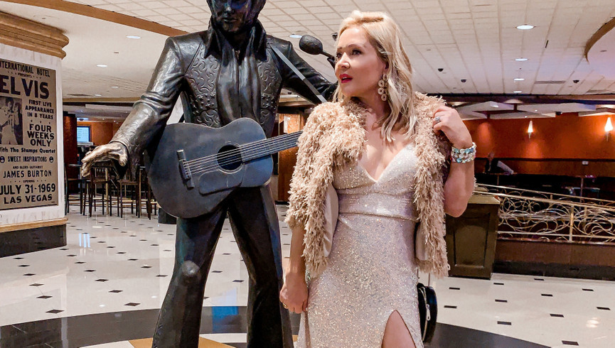 Woman standing next to Elvis Statue | Westgate Las Vegas Resort