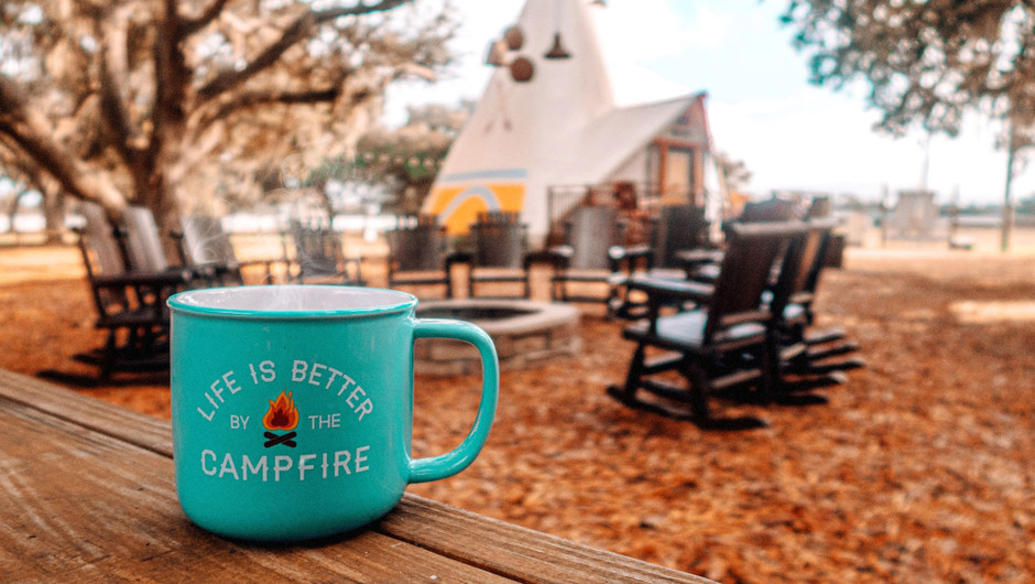 Coffee cup outside of Luxe Teepee Room for Glamping | Westgate River Ranch Resort & Rodeo | Westgate Resorts