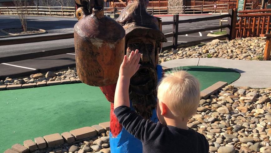 Child playing at mini golf - Westgate Smoky Mountain Resort
