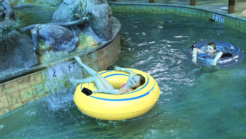 Kids laying in tubes in the lazy river at Wild Bear Falls Waterpark - Westgate Smoky Mountain Resort