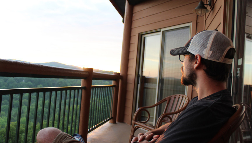 Guy on the balcony overlooking the mountains - Westgate Smoky Mountain Resort