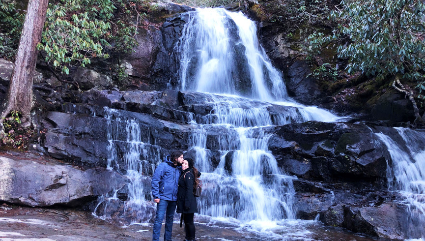 people hugging by a waterfall - Westgate Smoky Mountain Resort