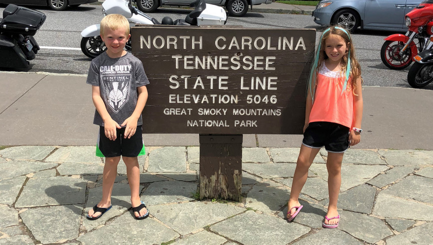 Kids standing at TN| NC State Line - Westgate Smoky Mountain Resort