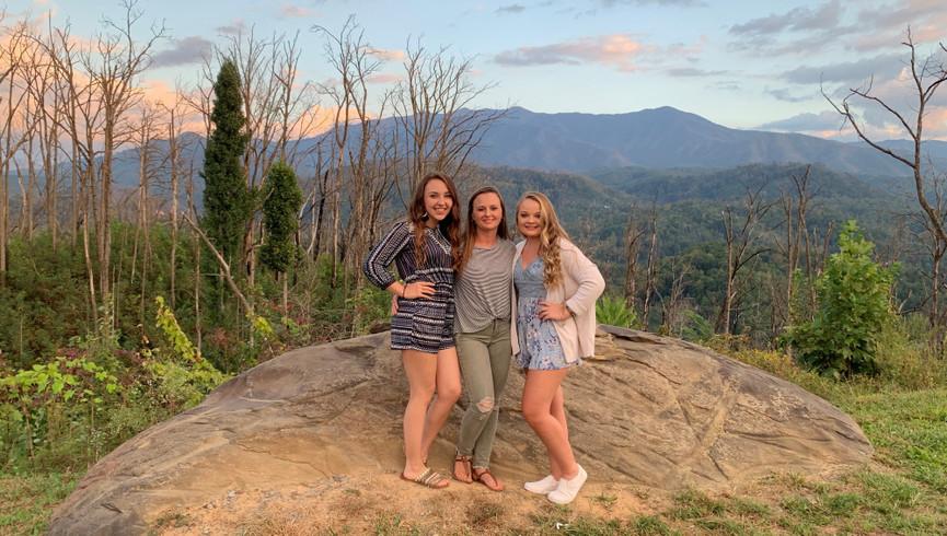 Girls posing in front of Gatlinburg Mountains - Westgate Smoky Mountain Resort