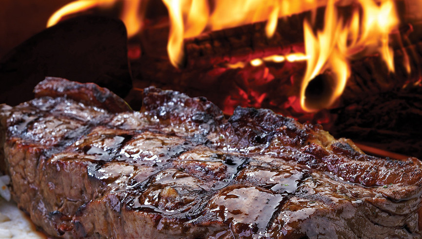 Steak grilling on an open flame - Westgate Smoky Mountain Resort