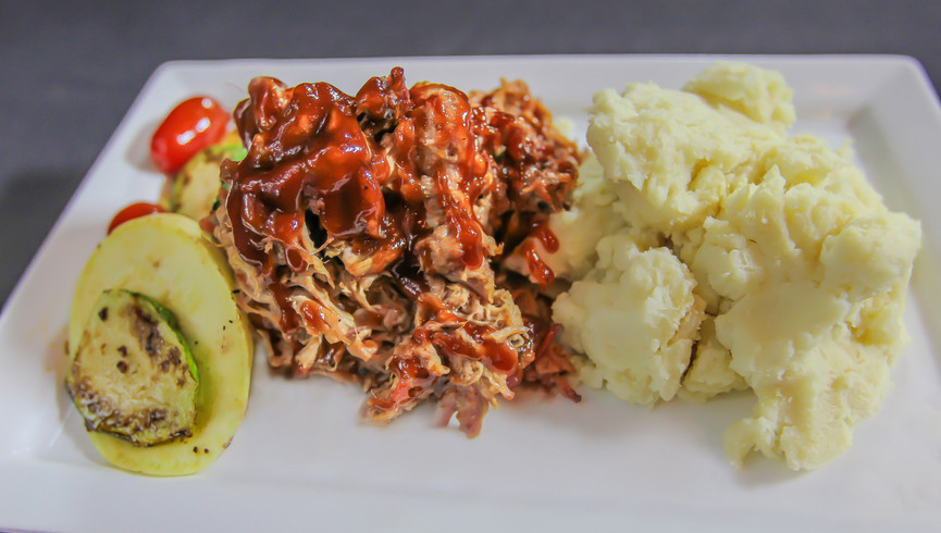 Pulled pork and mash with veggies on a plate - Westgate Smoky Mountain Resort