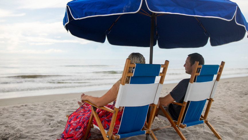 Couple sitting at Cocoa Beach | Westgate Cocoa Beach Resort