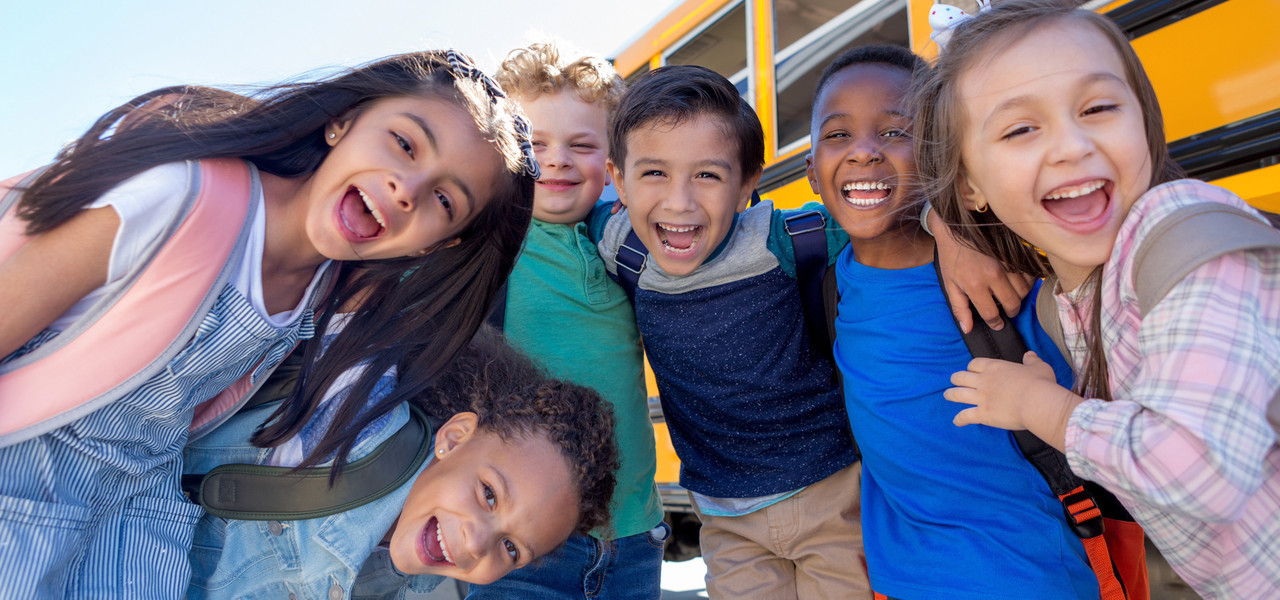 Make School Trips In Branson Fun And Affordable - kids in front of a school bus