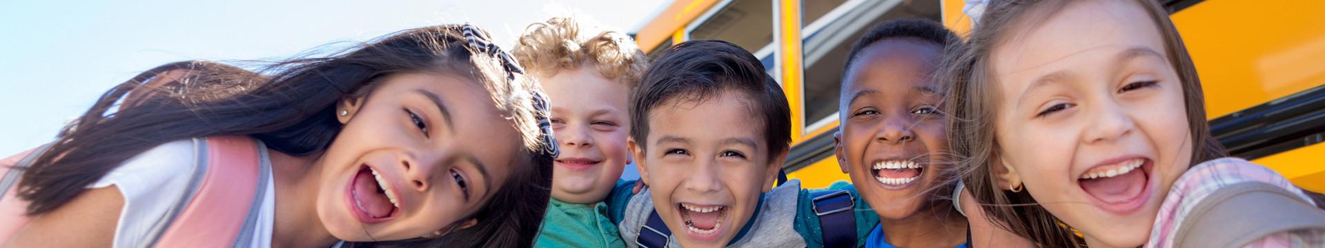 School Trip Hotel Deals Near Disney World - Kids near a school bus