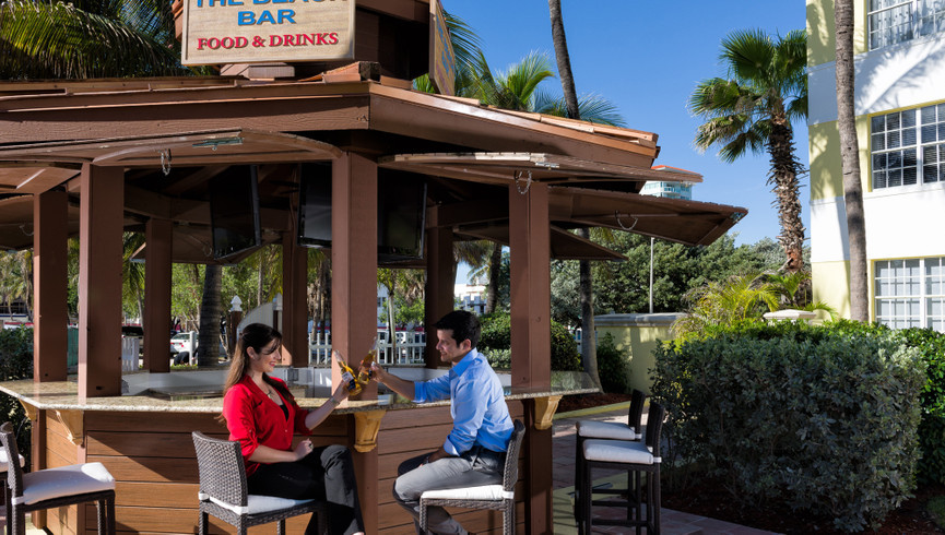 Couple sitting at a bar - Food & Beverage Jobs - Westgate South Beach Resort