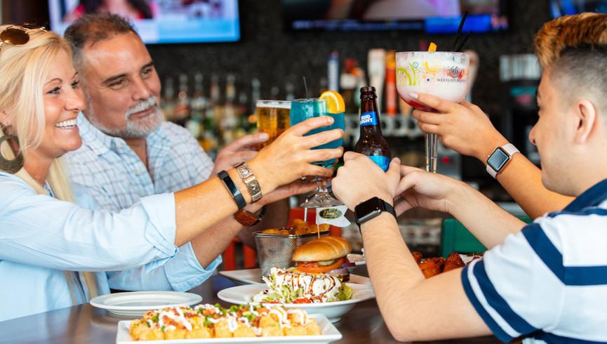 Friends cheering with their drinks - Food & Beverage Jobs - Westgate Myrtle Beach Resort