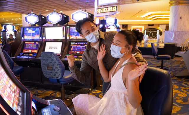 Couple Celebrating At The Casino With Masks Due To Covid Safety Protocols