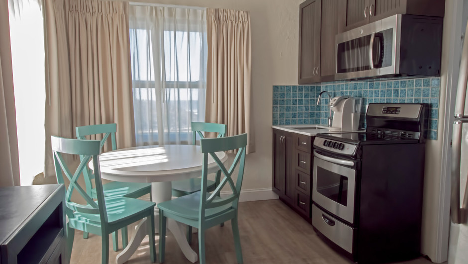 Kitchen with dining table in Seashell Suite - Sea View Inn