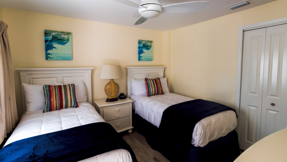 Two twin beds in the 2nd Bedroom in the Mangrove Suite - Sea View Inn