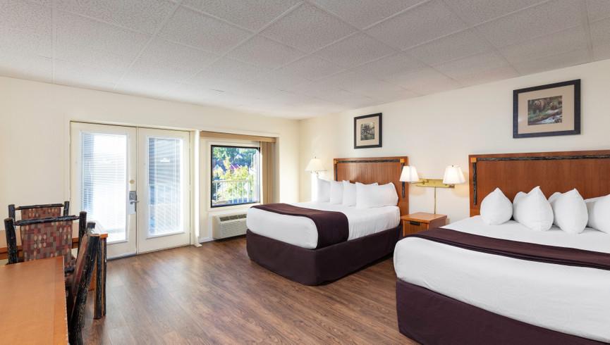 Bedroom in the Signature Queen Room | River Terrace Resort