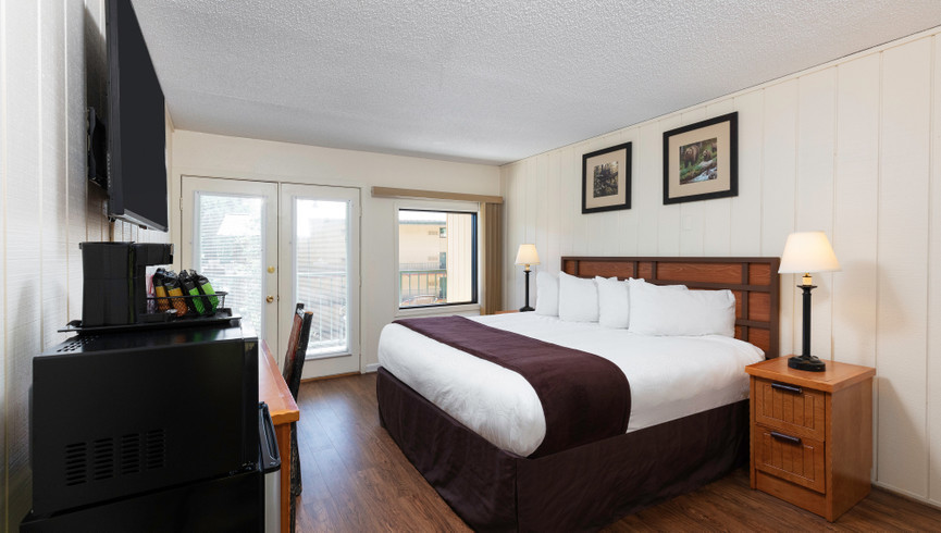 Bedroom in the Signature King Room | River Terrace Resort