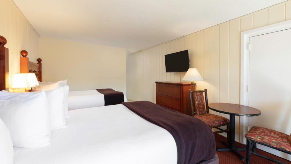 Bedroom in the Standard Queen Room | River Terrace Resort