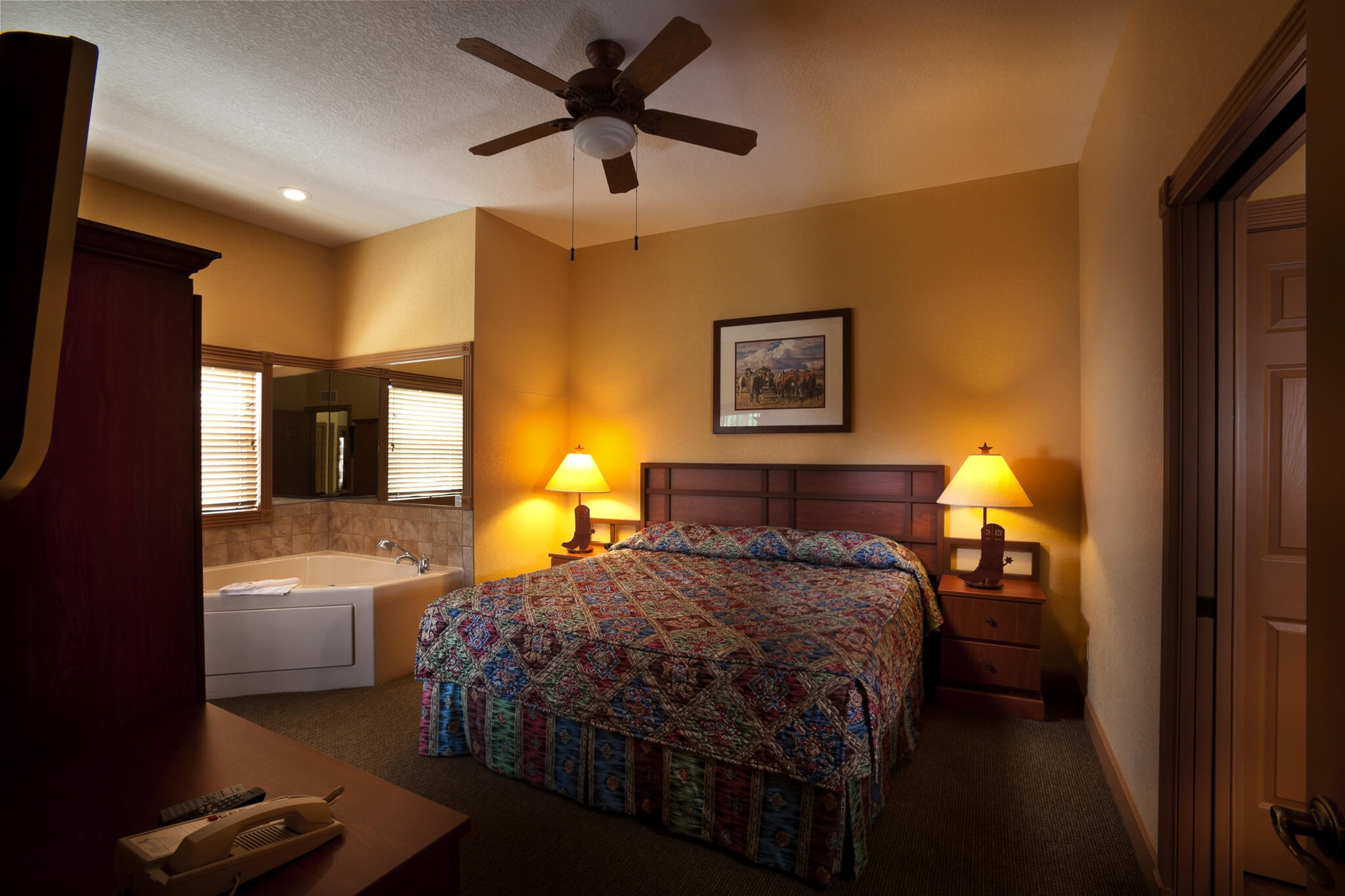 Bedroom with tub in one-bedroom Saddle Club room - Westgate River Ranch