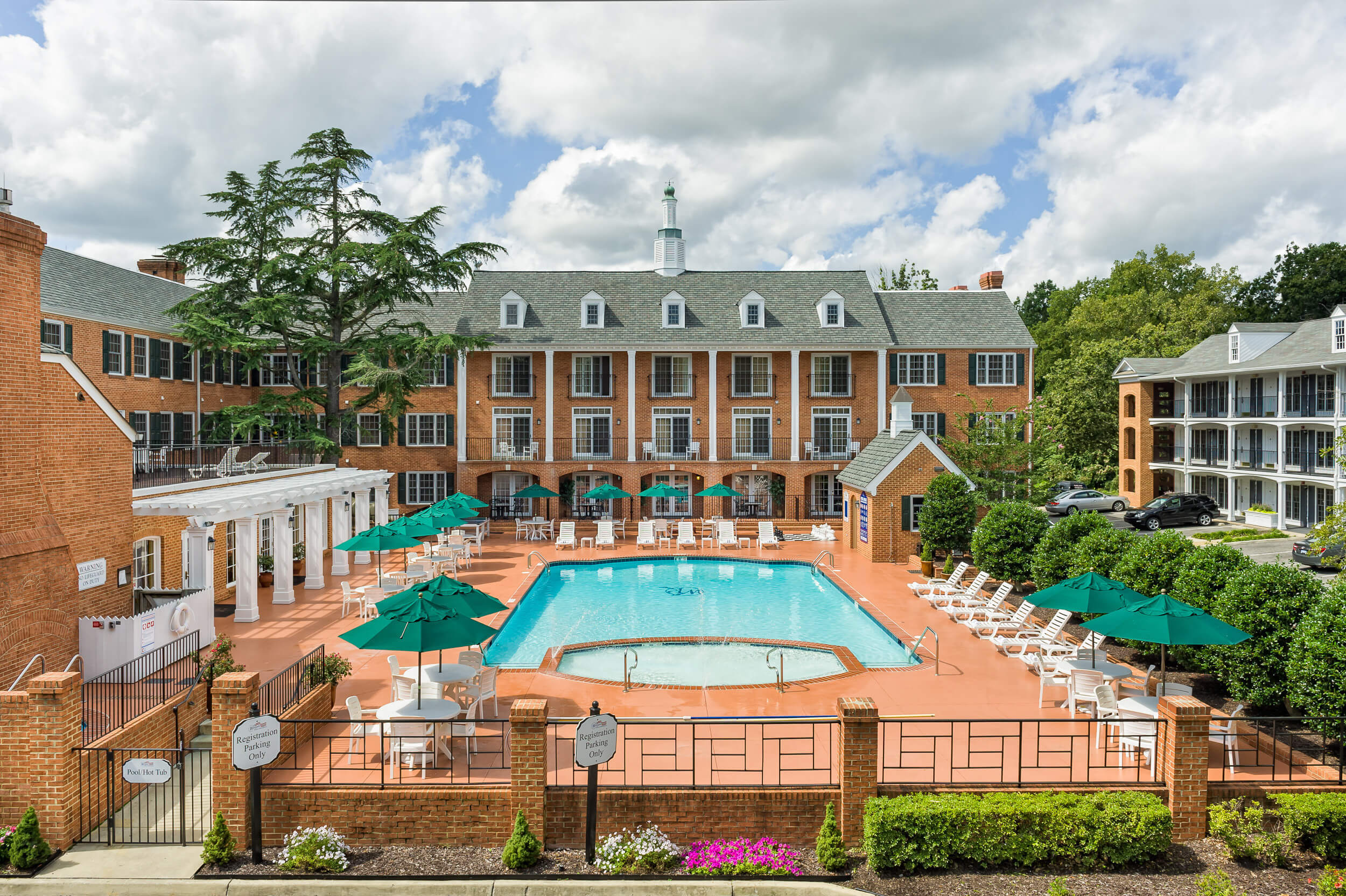 Colonial-style resort building with heated outdoor pool | Westgate Historic Williamsburg Resort