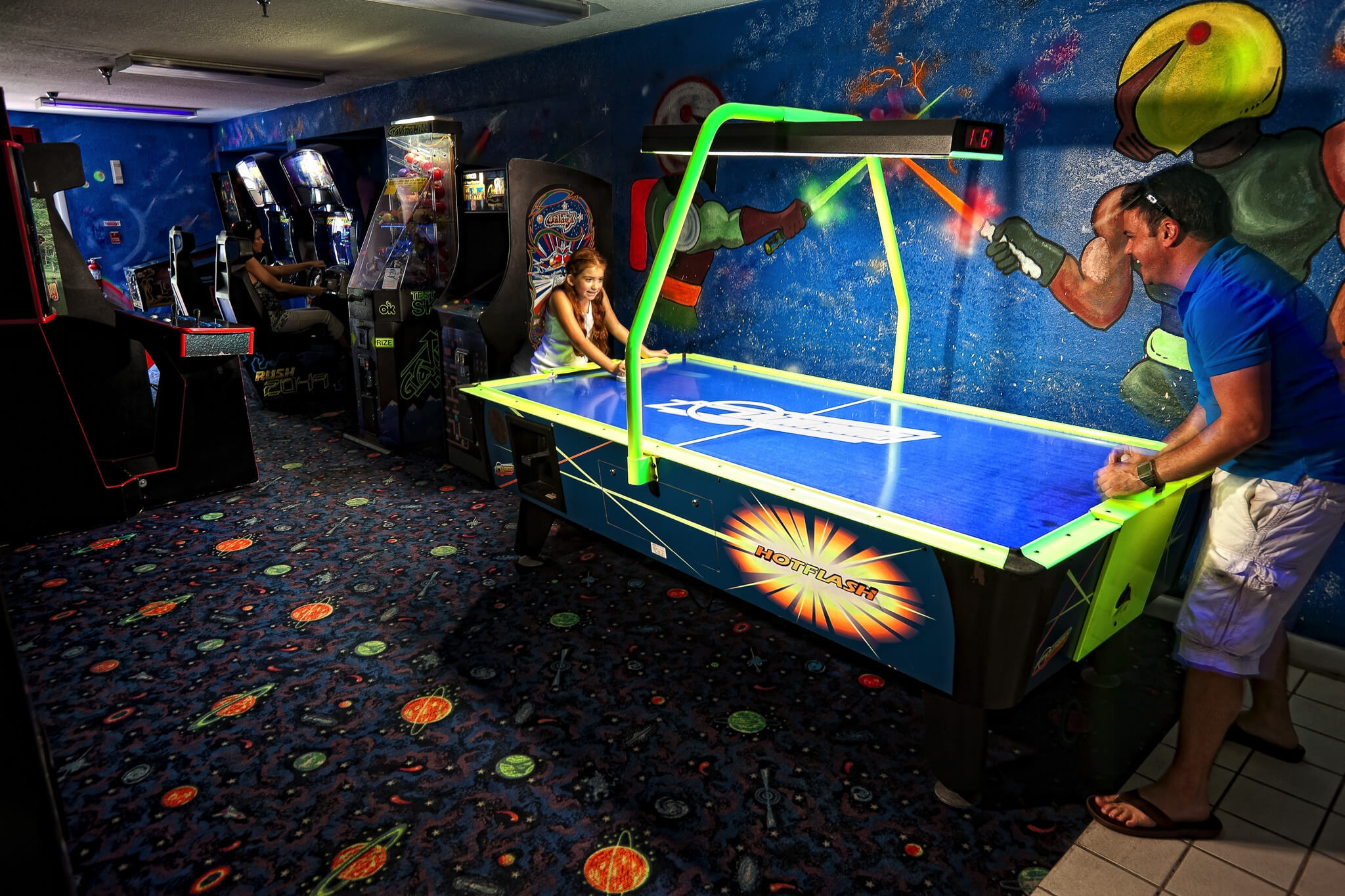 Kids playing air hockey in Game Room | Westgate Blue Tree Resort | Westgate Resorts Orlando