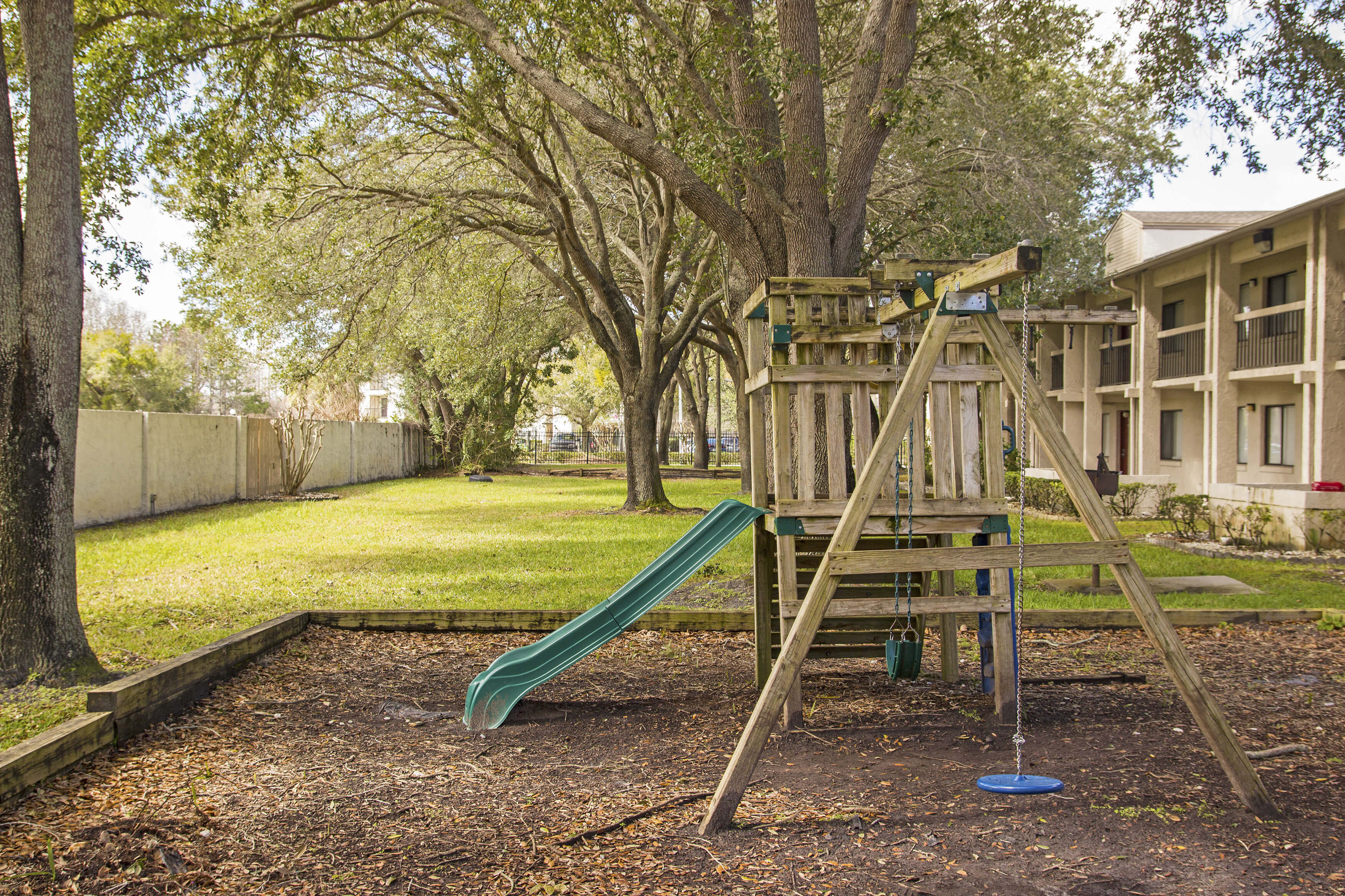 Club Orlando children's play area with plenty of space to have fun under the shade of the trees | Westgate Resorts in Orlando FL