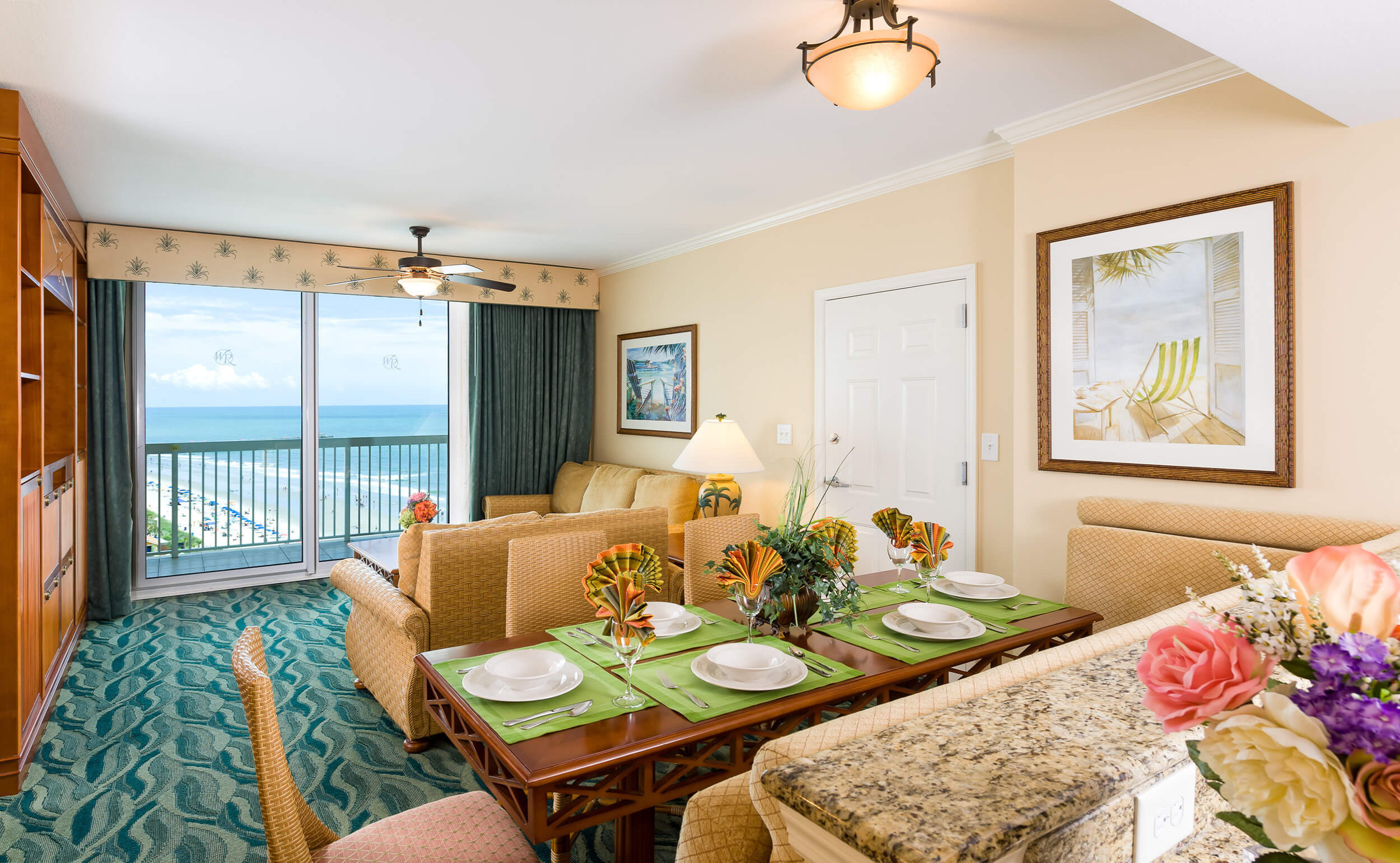 Dining table and living area in One-Bedroom Deluxe Ocean View Villa | Westgate Myrtle Beach Oceanfront Resort