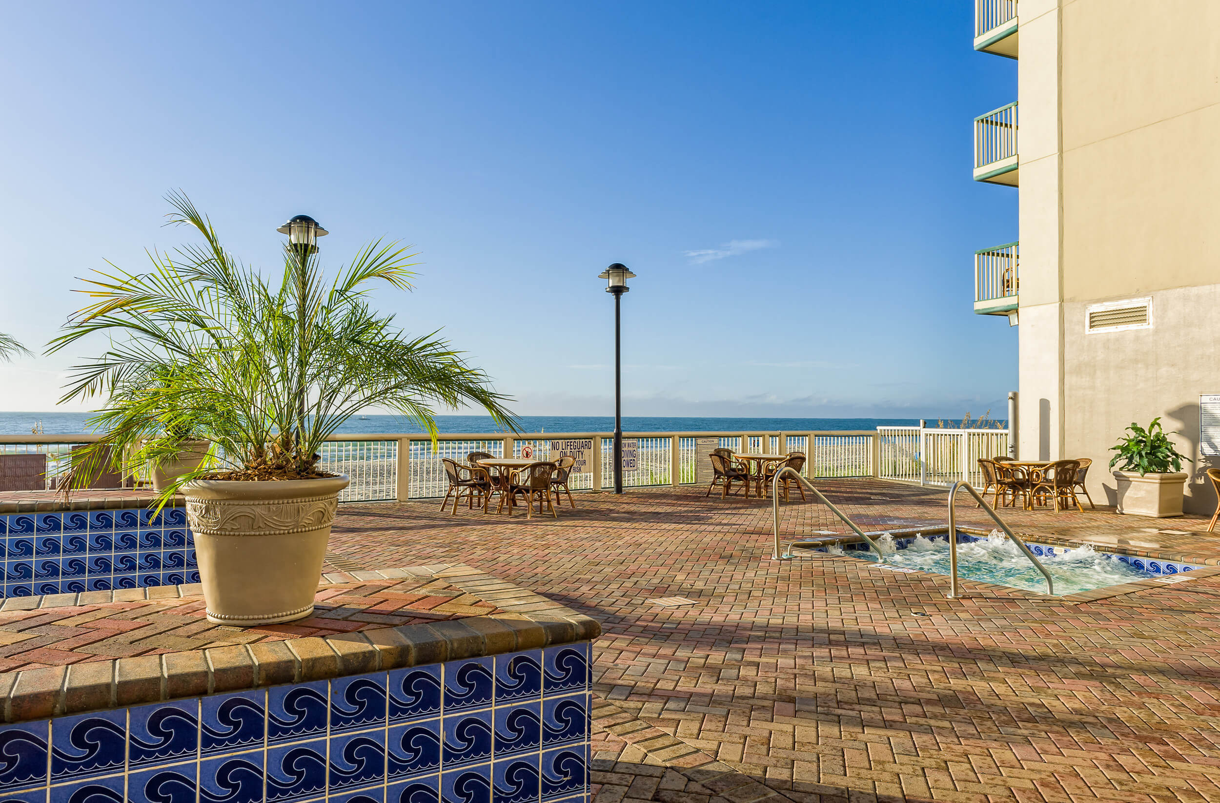 Outdoor beachfront deck with tables and chairs | Westgate Myrtle Beach Oceanfront Resort