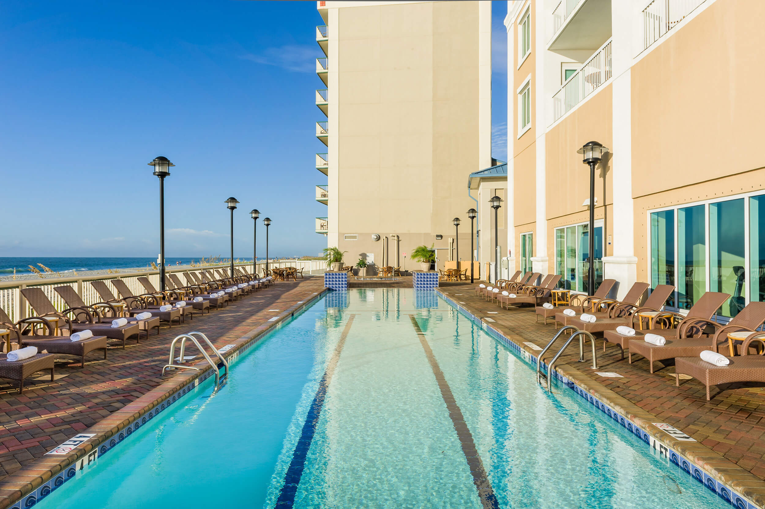 Large heated outdoor pool with lounge chairs | Westgate Myrtle Beach Oceanfront Resort