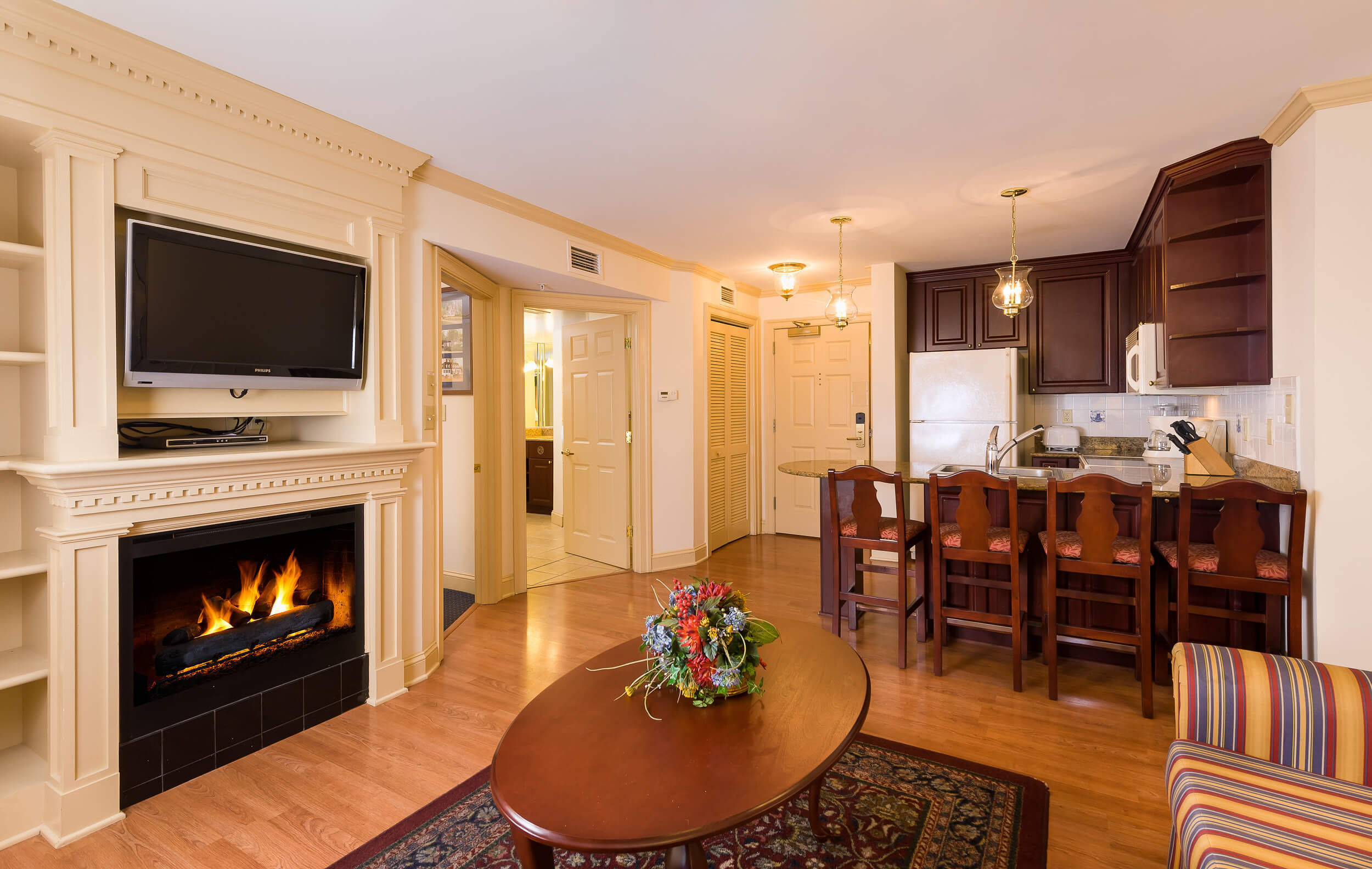 Living area and fully equipped kitchen in Two-Bedroom Villa | Westgate Historic Williamsburg Resort