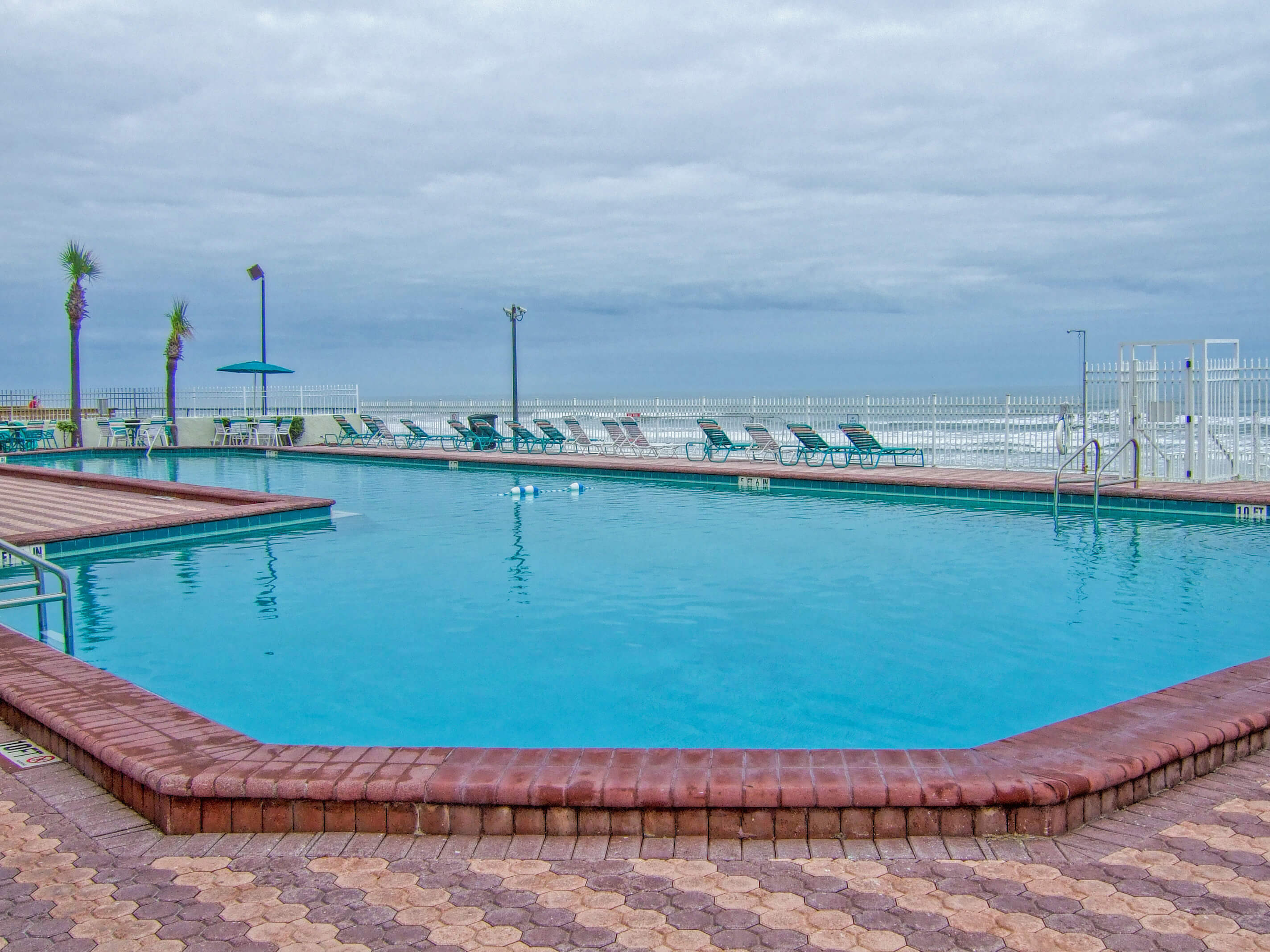 Large heated outdoor pool with lounge chairs | Harbour Beach Resort | Westgate Resorts in Daytona Beach FL