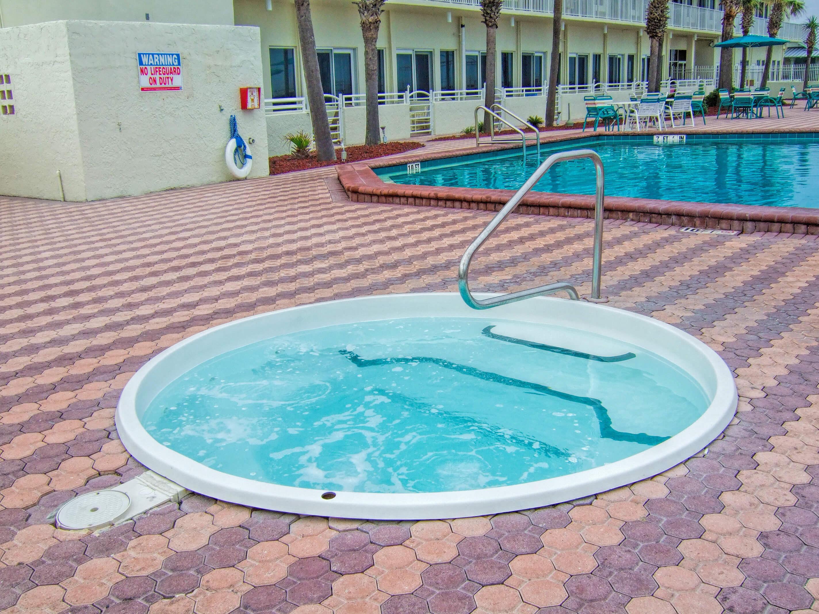 Hot tub and heated outdoor pool | Harbour Beach Resort | Westgate Resorts in Daytona Beach FL