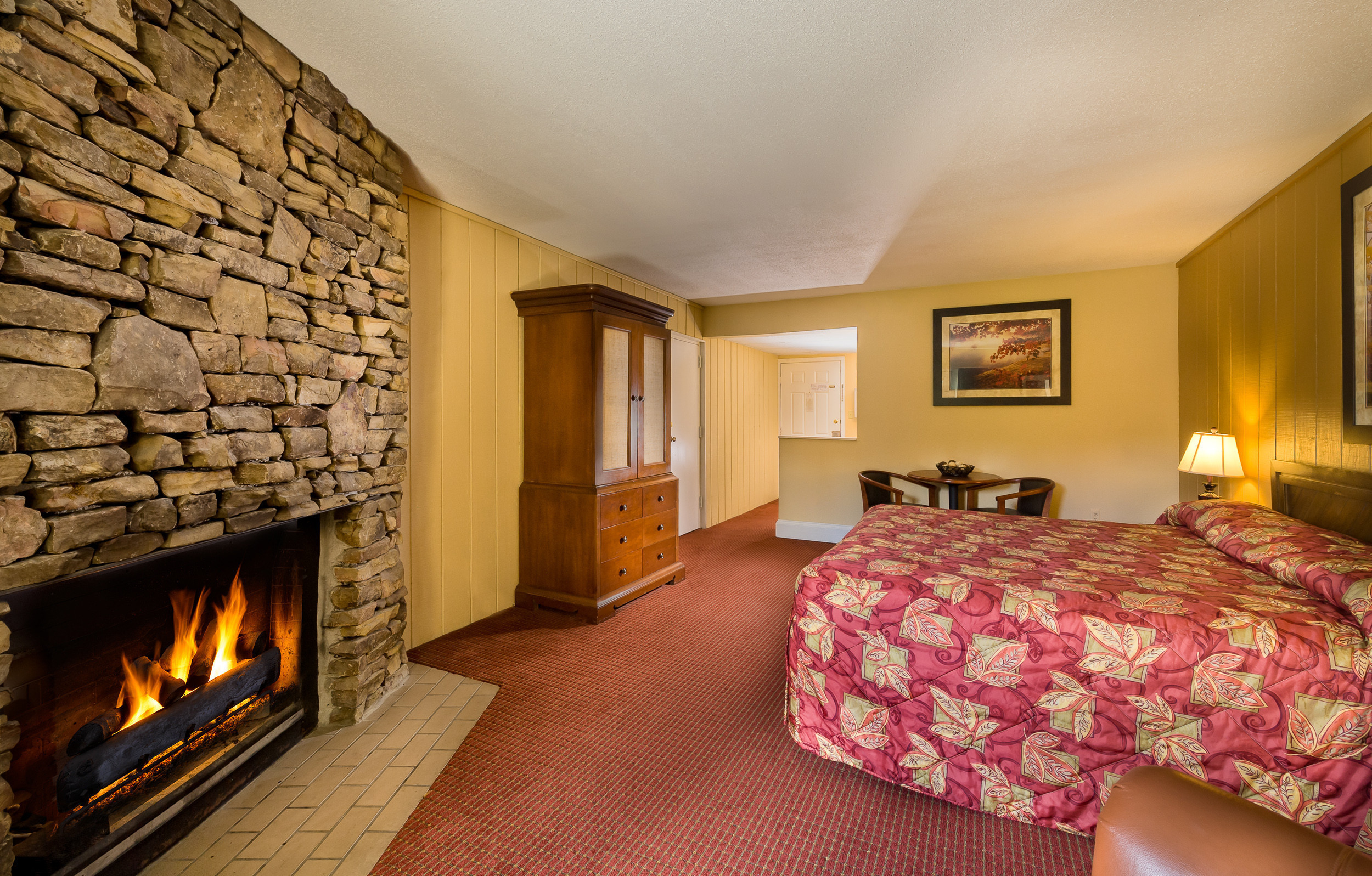 Fireplace and King Bed in Standard King Room | River Terrace Resort & Convention Center | Westgate Resorts