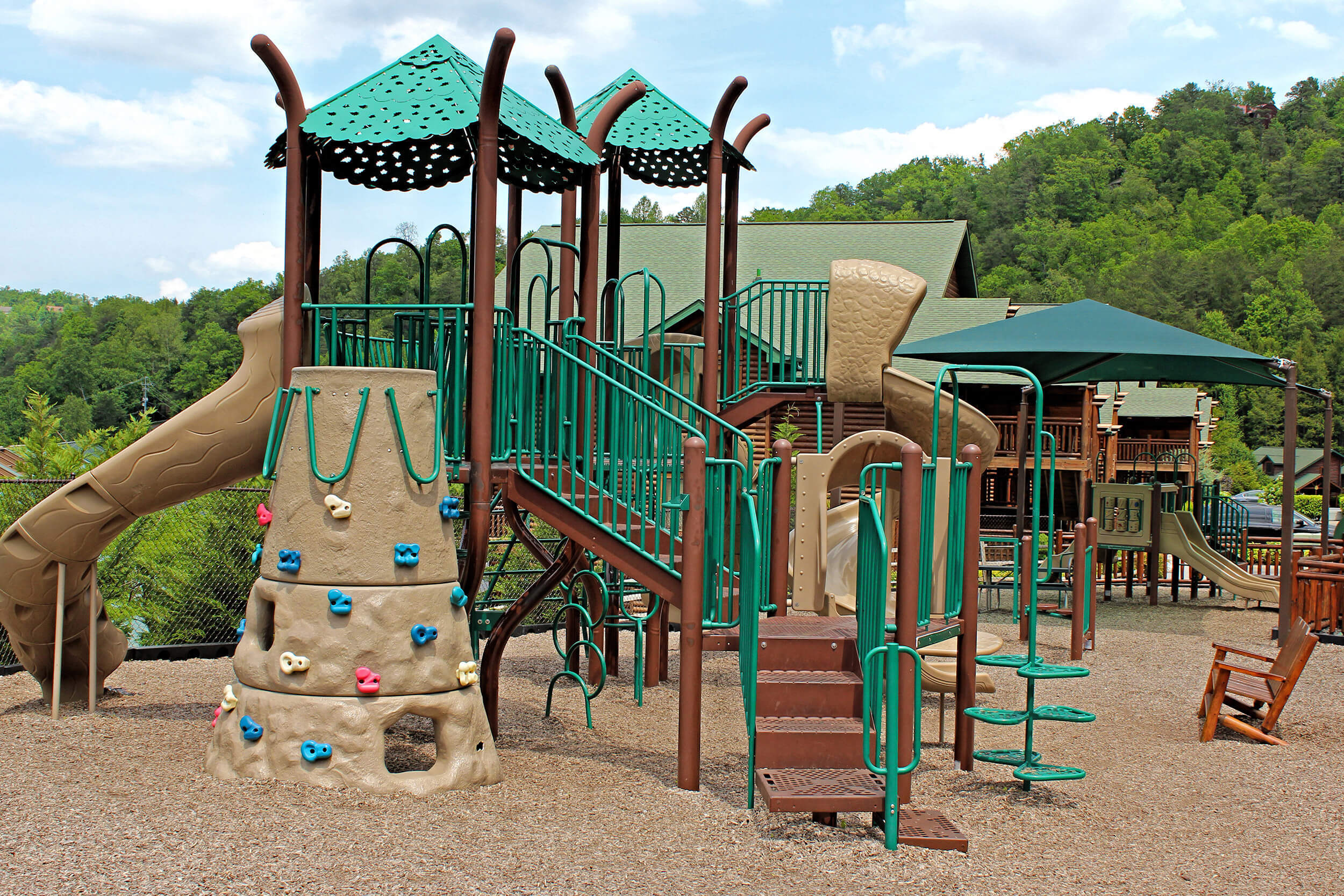 Onsite Playground with mountains in background | Westgate Smoky Mountain Resort & Spa