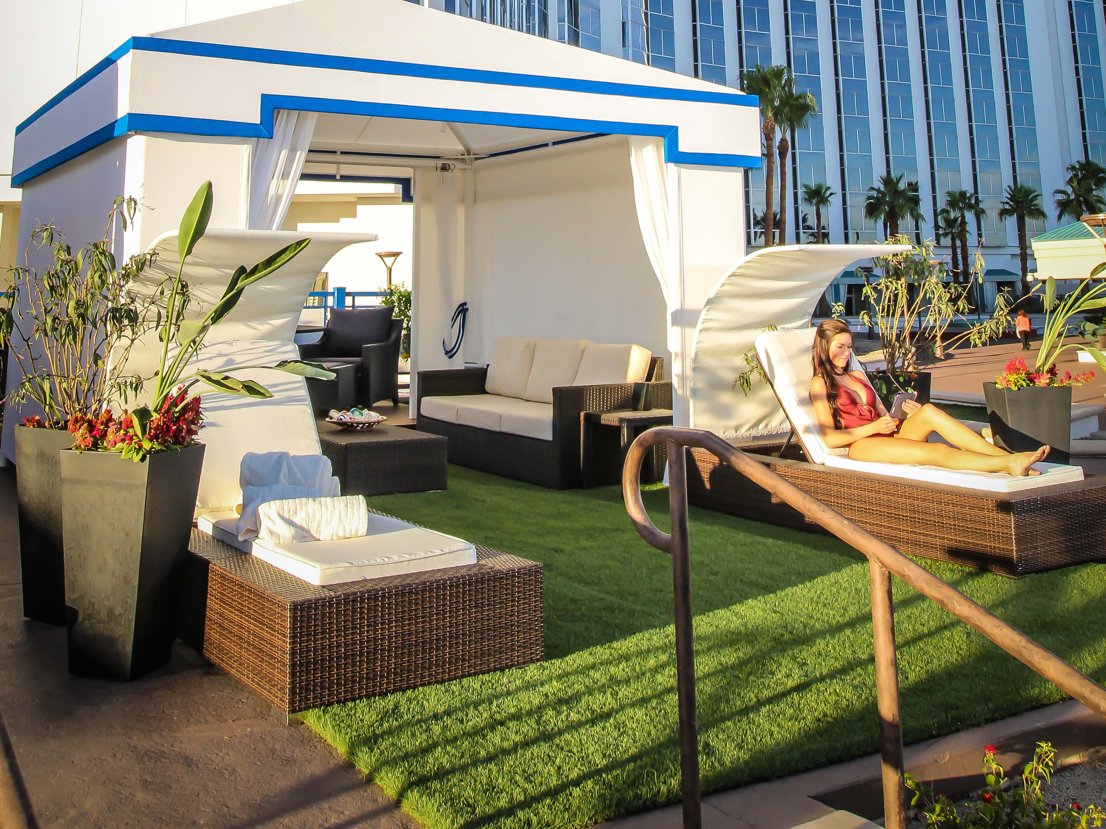 Pool Cabanas at our Las Vegas Hotel and Casino | Woman Headed to Pool Cabana