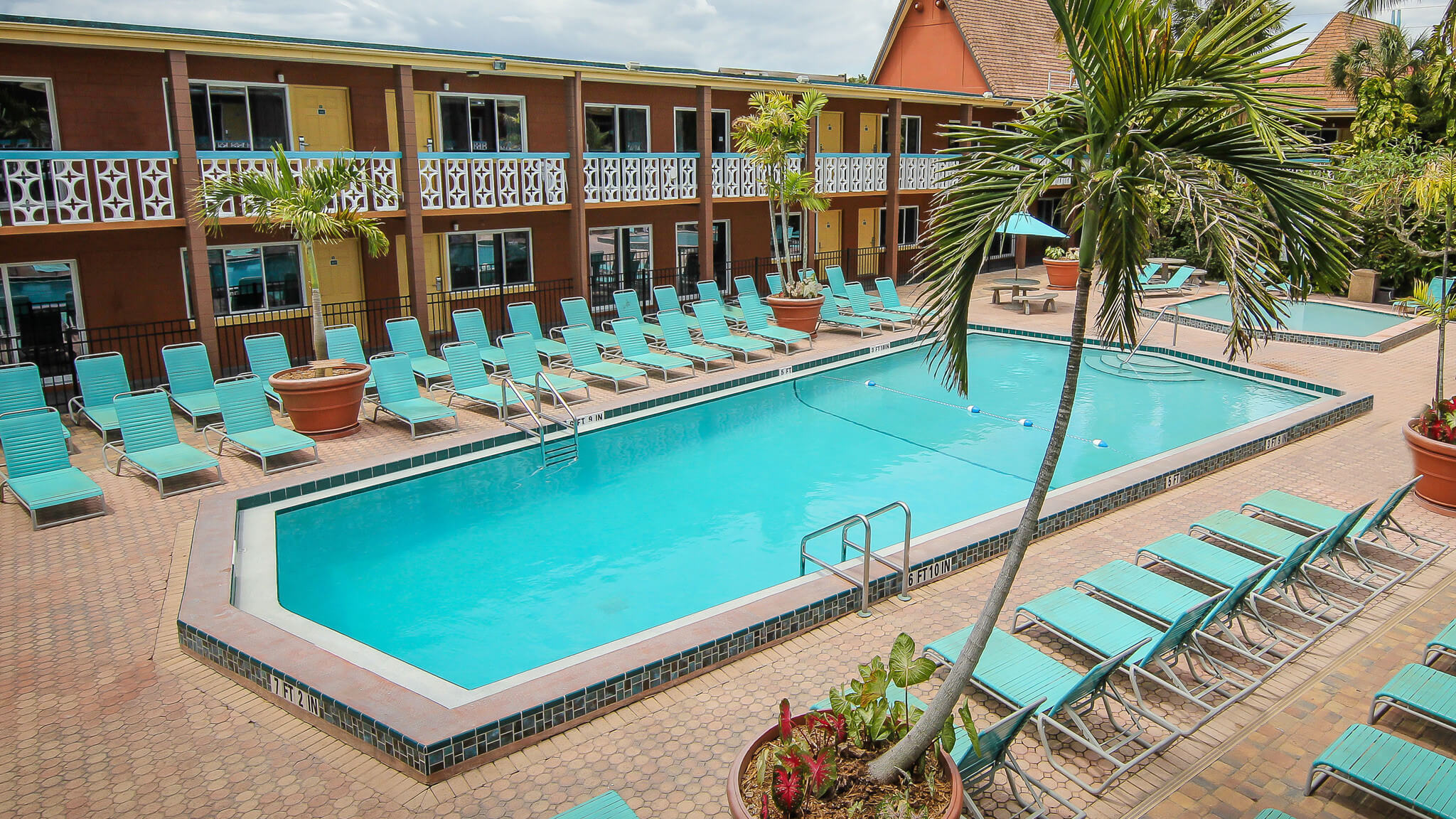 Heated outdoor pool with lounge chairs | Wakulla Suites a Westgate Resort | Westgate Cocoa Beach Resorts
